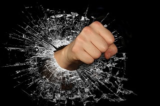 Fist breaking glass